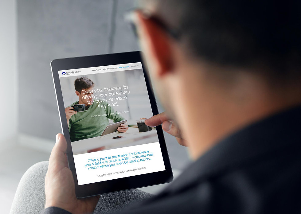 Man browsing the brand launch website on an iPad