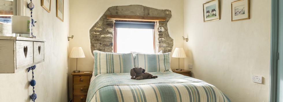 Delfryn Swallows Cottage Bedroom 1.jpg