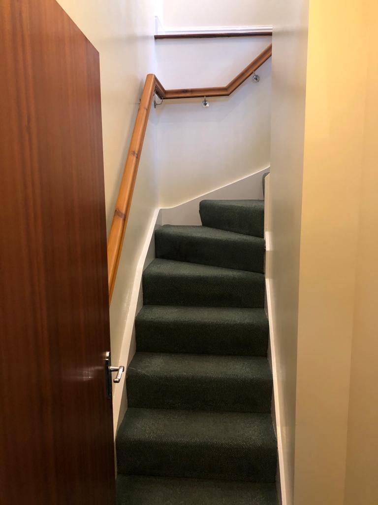 Stairs leading to upstairs lounge.png