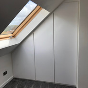 Built in wardrobes maximising the space in this loft room