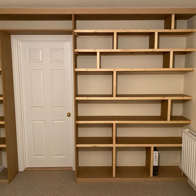 Stud wall, door hung, skirting and architrave fit and custom shelves.