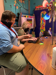 Josiah teaching on computer