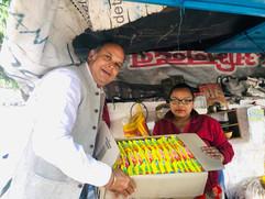 Amit-Sachdeva-Distributing-Maggi-Packs.j