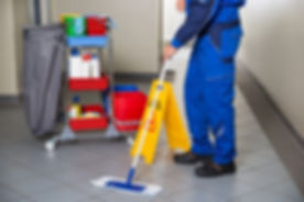 Low section of male janitor with broom c