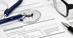 Stethoscope shown on top of generic medical forms