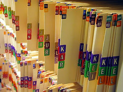 Shelves of many medical record folders are shown
