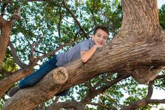 Boy on tree branch-11.JPG
