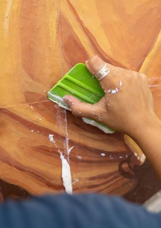 Raysa Installing the Mural