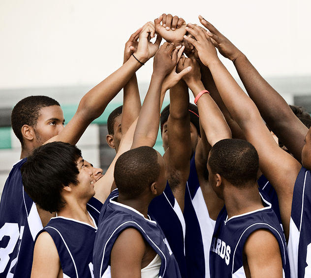 Arms Raised in Huddle