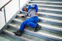 Worker Man Lying On Staircase After Slip