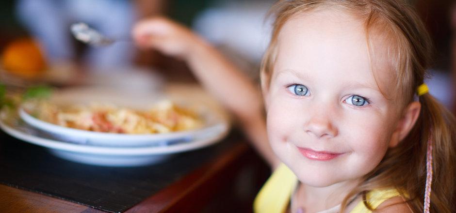 Portrait of adorable little girl having