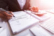 085381446-close-businessperson-calculati