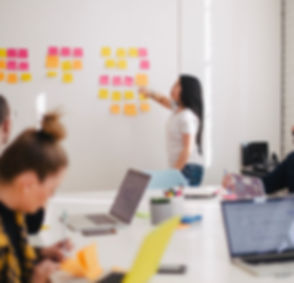 woman placing sticky notes on wall_edited.jpg