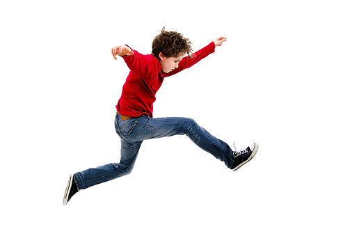 Boy jumping, running isolated on white b