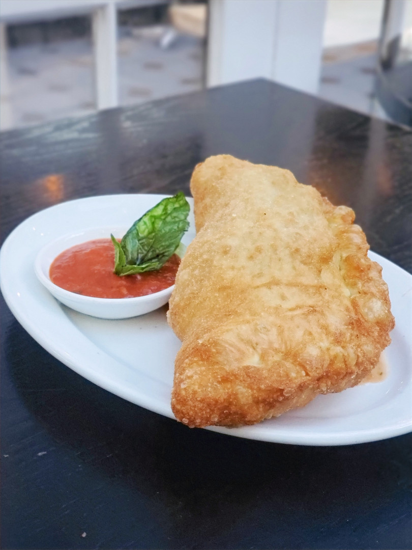 Margherita Calzone and Your choice of Pizza  $25