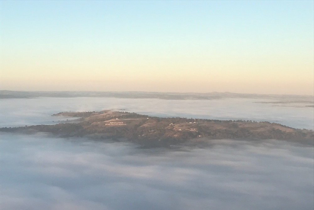 Mount Panorama surrounded by an ocean of fog....... the only land mark visible