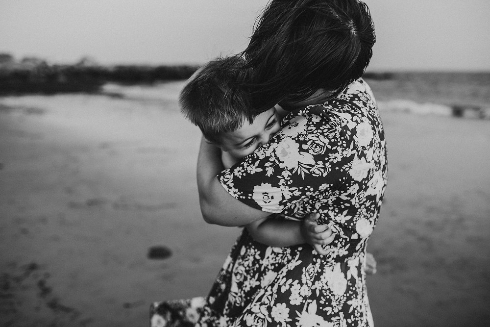 Westerly Rhode Island Beach Photo Session, mother holding and kissing laughing son at Napa Tree Point in Westerly