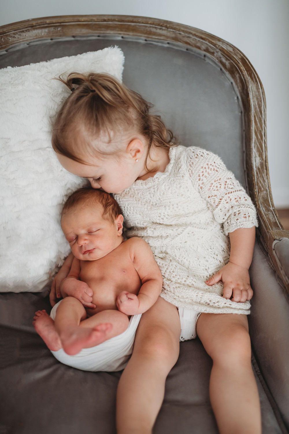 sibling love with newborn baby girl