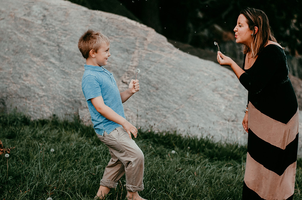Mother and Son at Rocky Neck State Park blowing dandelions | family photography | dacia vu photography