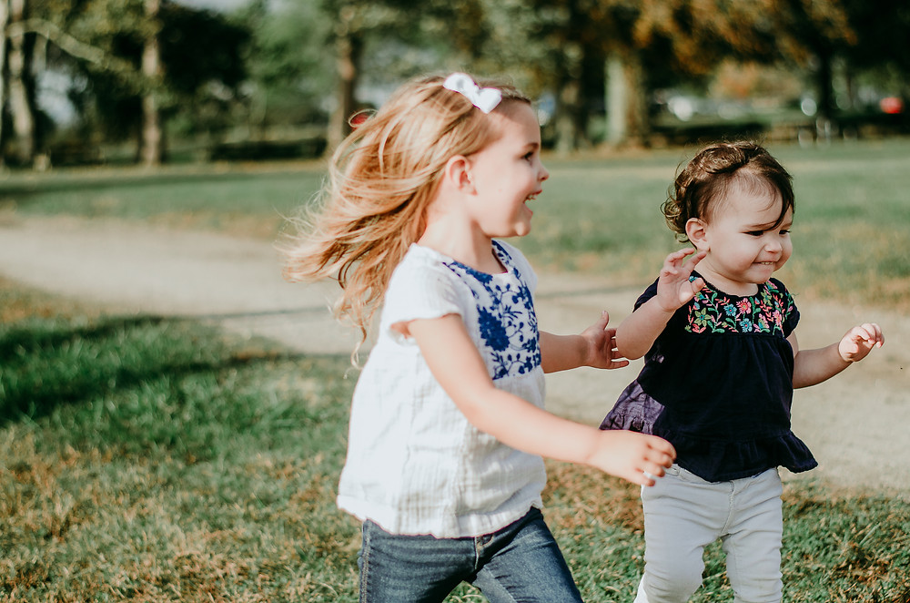 siblings laughing, running, playing together during family photo session | dacia vu photography, Preston CT photographer