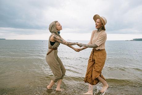 women-holding-hands-on-beach-3727554.jpg