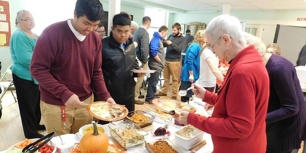 In Gathering Meal Celebrating Thanksgiving