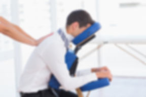Businessman having back massage in medical office.jpg