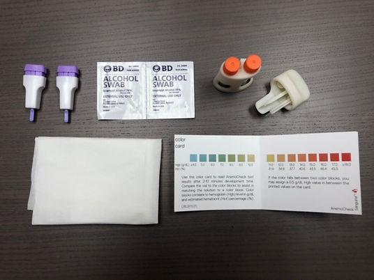 top-down view of the contents of AnemoCheck home test kit