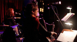 Sandy performing with Caroline Waters