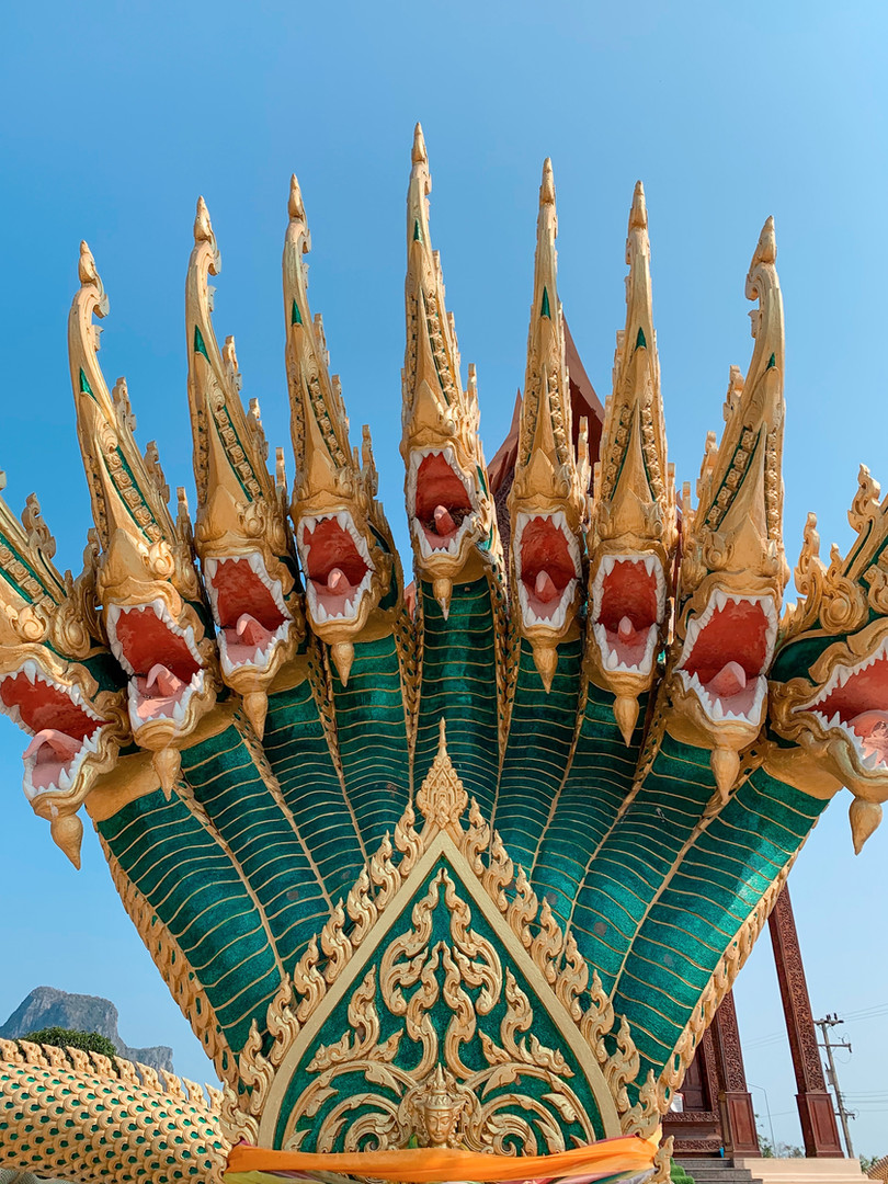 Ao Noi Temple   Khan Kradai Cava Temple is located at Noi bay before reaching the city Pracchuap, it has the split ring to to Petchakasem road at 314th km. The temple area is in Thai style architecture, all created from grandis, natural cave with Slumber Buddha older than 300 years.