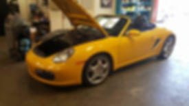 Porsche 987 at German Autohaus of Chattanooga Tennessee for repair Boxster S yellow Maintenance European Car