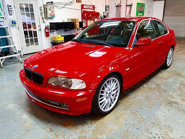 A beautiful Electric Red 2002 BMW 330i c