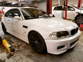 An Alpine White 2003 BMW E46 M3 in for t