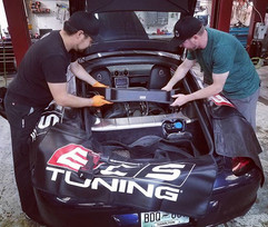 Andrew and Dominic prepping a 2006 Porsc