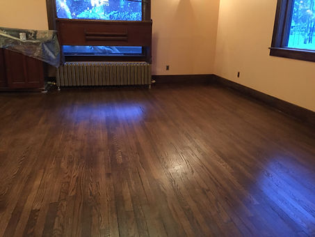 After picture of wood floor after being sanded and refinished