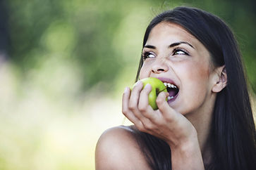 young girl eating apple