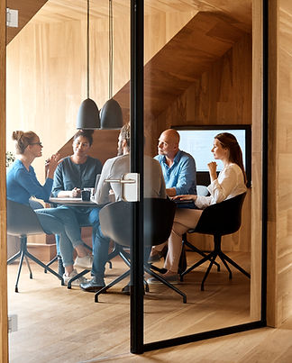 Business meeting in a conference room between employees