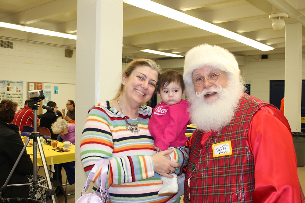 This was this little girl's first photo with Santa.