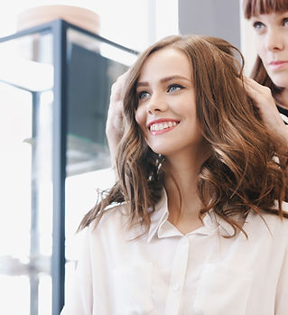 Closeup hairdresser makes hairstyle for