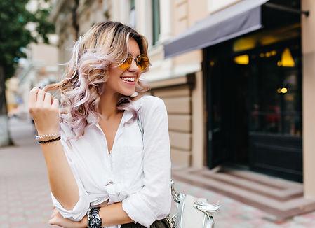 Pretty girl wearing sunglasses and brace