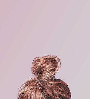 A view of the back of a woman's head. Ha