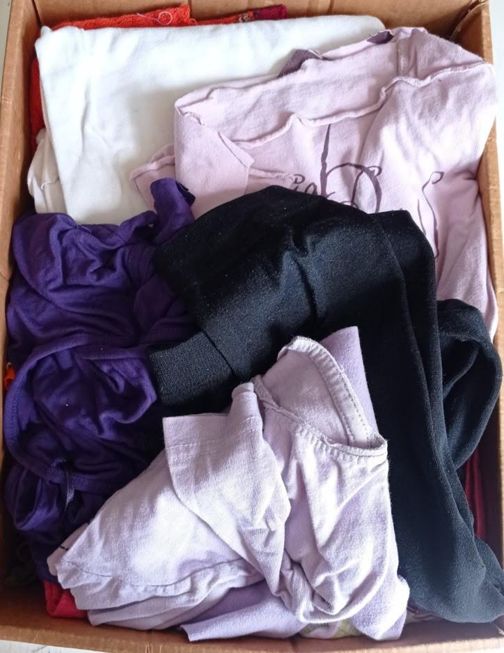 Box of used t shirts