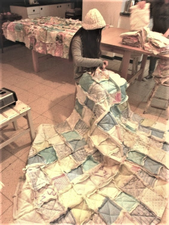 Children sewing reag quilts from upcycled clothing