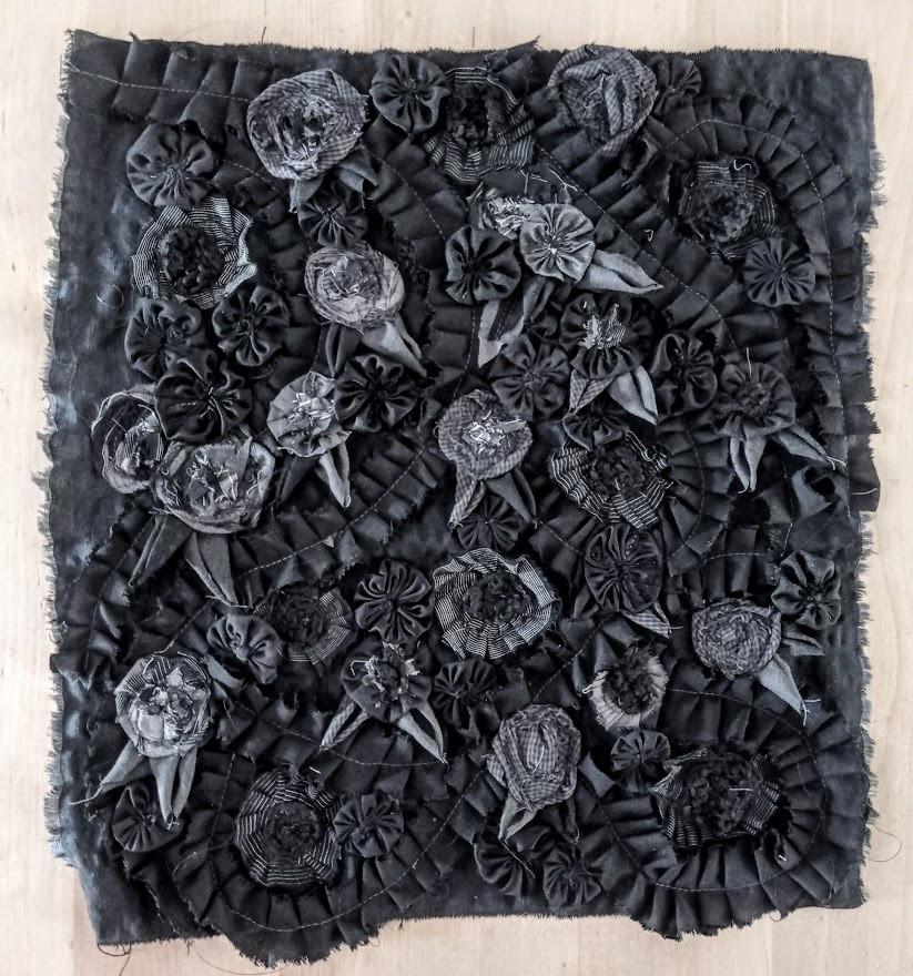 Black and grey roses on black satin