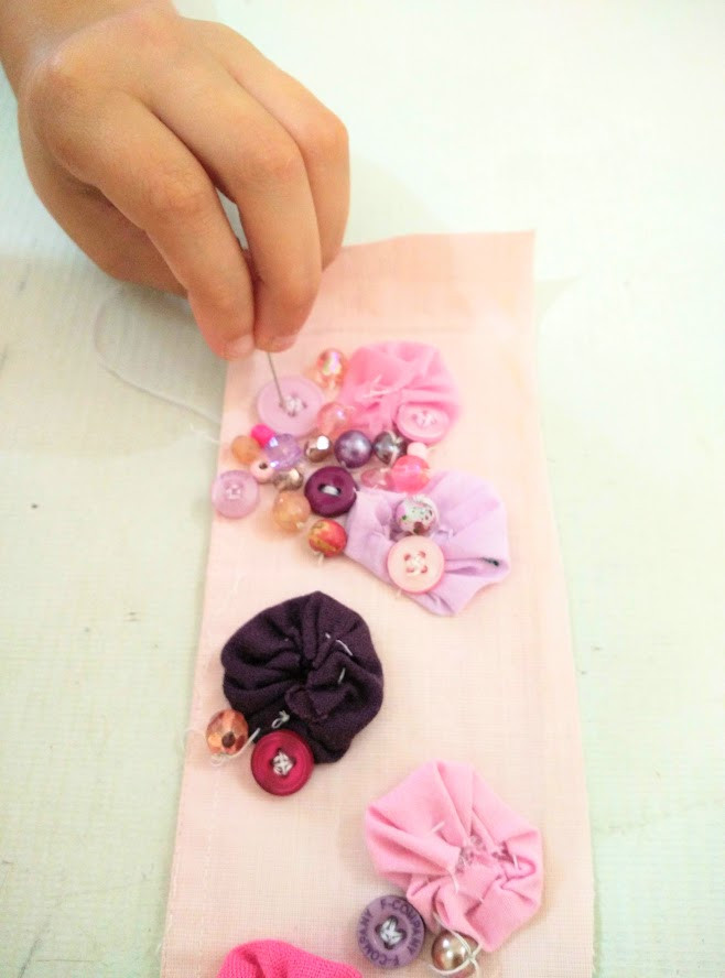 Learning to stitch buttons and beads