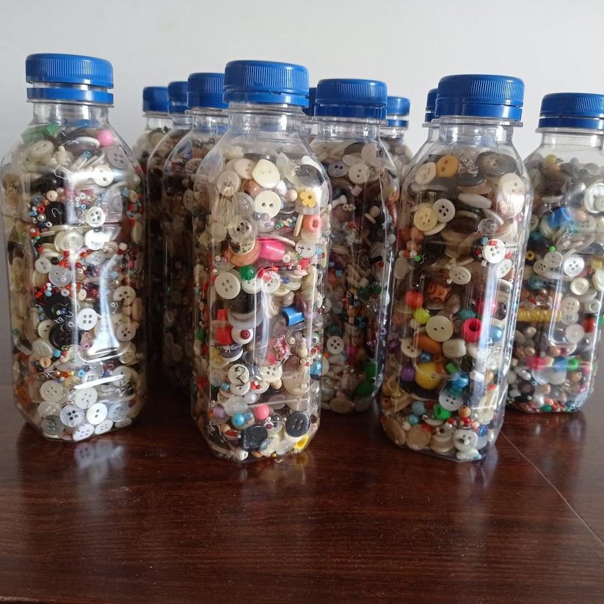 Button filled bottles