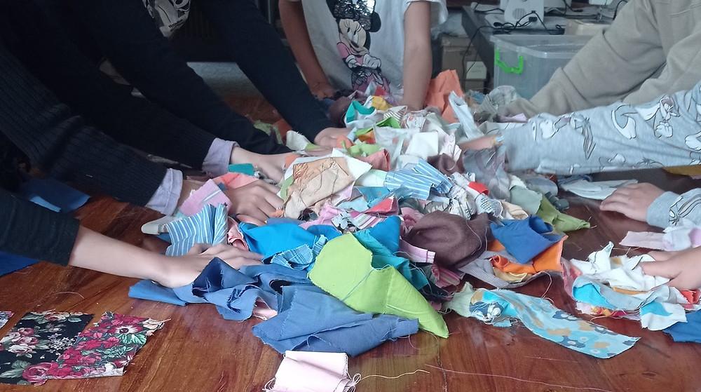 Choosing fabric from the scrap bag