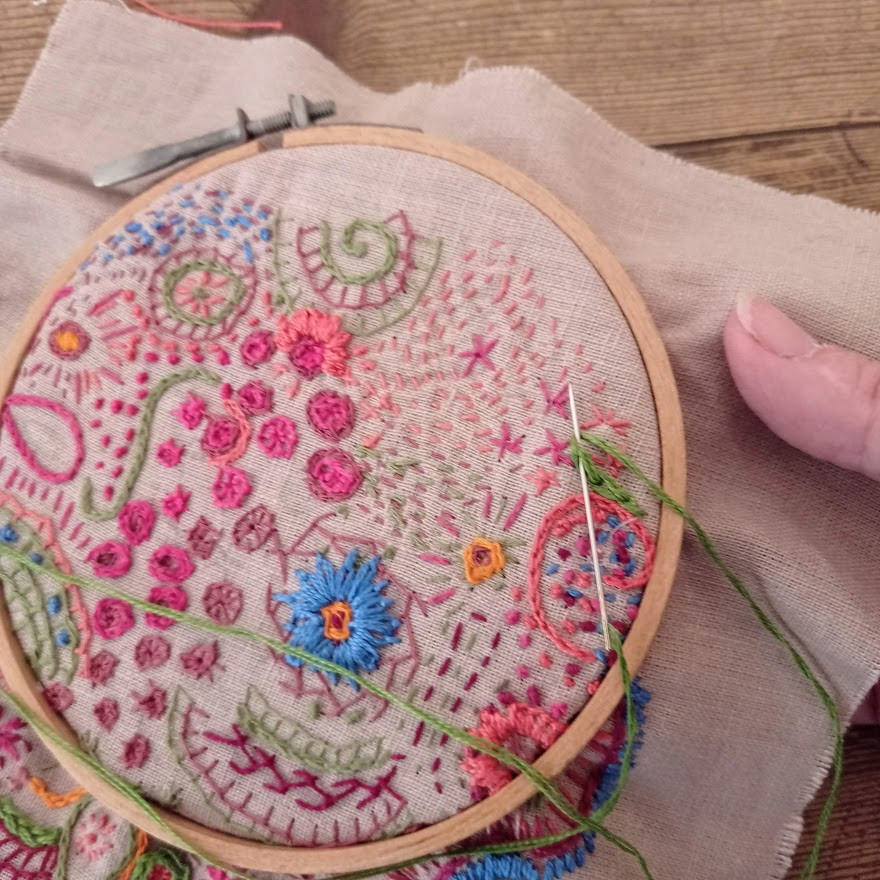 Embroidering in greem