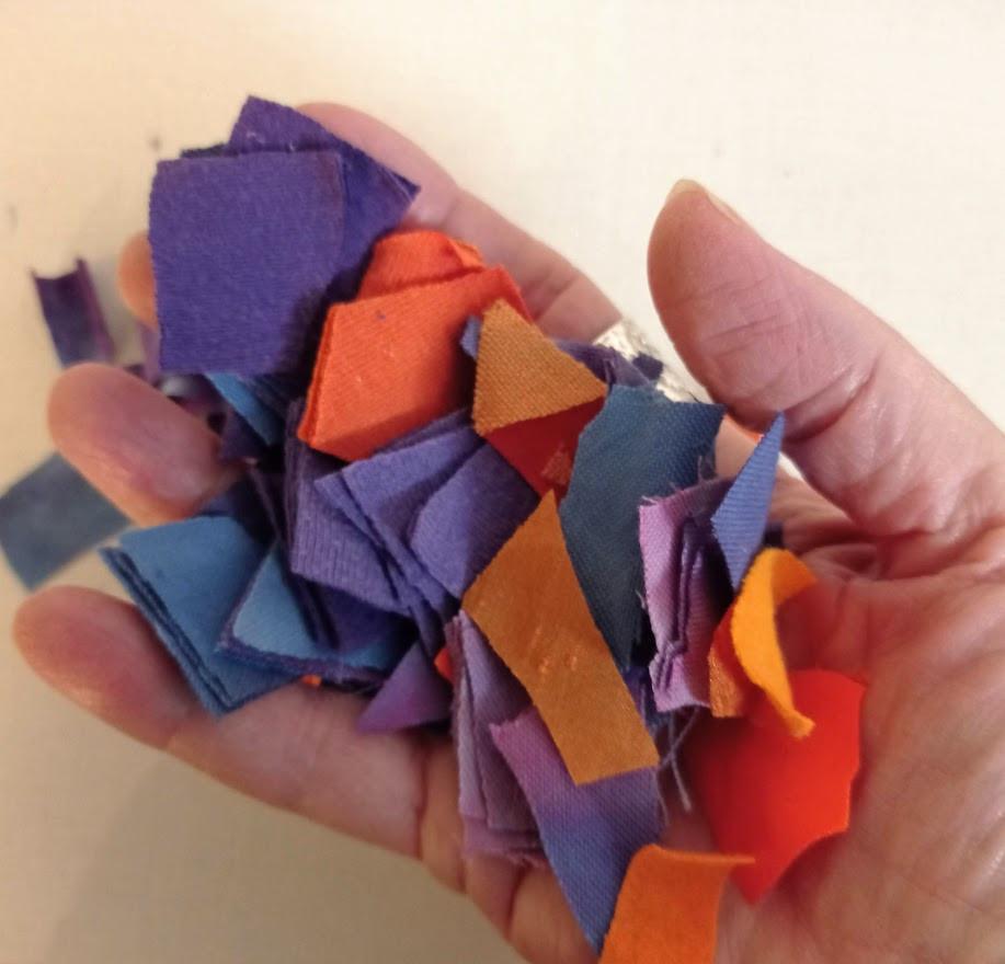 Orange and purple fabric scraps