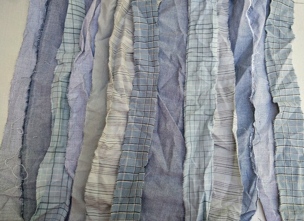 Torn grey shaded strips
